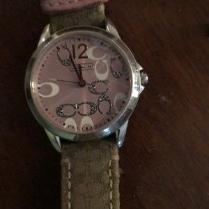 Coach khaki signature watch with pink accents.